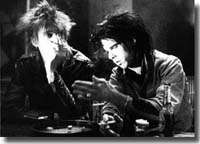 "Blixa and Nick Cave playing dice, (first day of both together infront of camera), 30.april 1986, in ""Clip"", Yorkstraße, Berlin"